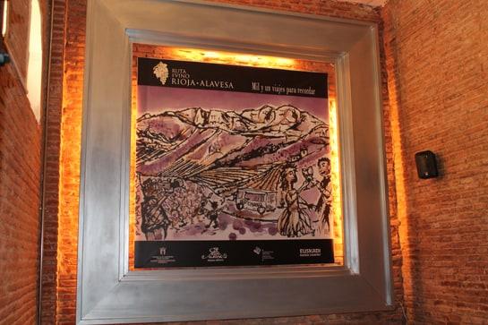 Cartel realizado por Jabier Goyoaga en tinta y vino de Rioja Alavesa / JC Morales